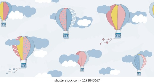 Vector seamless pattern with balloons and clouds. Children's pattern. Vector textile fabric print.