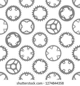 Vector seamless pattern with bike chainrings (chainwheels, sprockets) isolated on white background.
