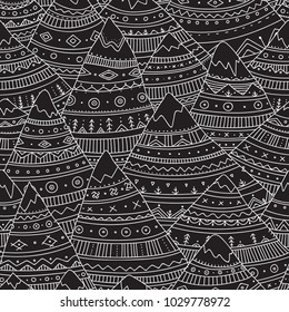 Vector seamless pattern with boho ornamental mountains. Can be printed and used as wrapping paper, wallpaper, textile, background, etc.