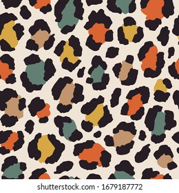 Vector seamless pattern with colored leopard print. Animal print. Cheetah print. Colored safari background.