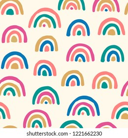Vector seamless pattern with colored rainbows. Simple repeated texture with bright design elements. Tenmplate for baby textile and wrapping paper. Geometric background with hand drawn elements.