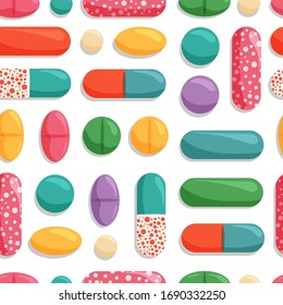Vector seamless pattern with colorful pills. Medical, pharmaceutical symbols isolated on white background.