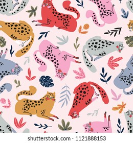 Vector seamless pattern with cute cheetahs on the pink background. Tropical animals. Fashionable fabric design and tropical print.