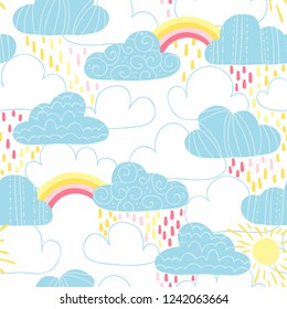 Vector seamless pattern with cute clouds, raindrops, sun and rainbow. Great for wrapping paper, textiles, children's clothing, wallpaper, etc.
