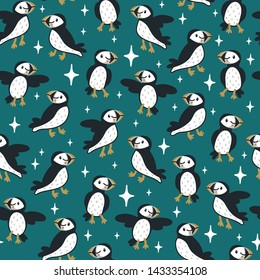 Vector seamless pattern with cute puffins and sparkles. Repeated texture with icelandic birds. Childish print for kids fabric and wrapping paper with cartoon characters. Scandinavian style.