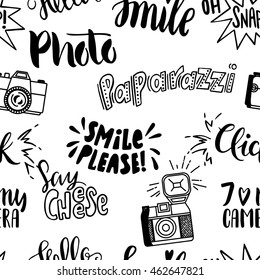 Vector seamless pattern with cute retro cameras.