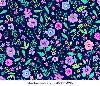 Vector seamless pattern. Cute pattern in small flower. Small lilac and purple flowers. Dark blue background. Ditsy floral background. The elegant the template for fashion prints.