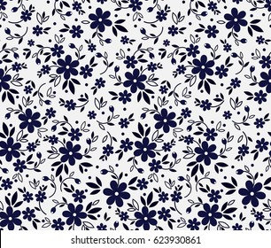 Vector seamless pattern. Cute pattern in small flower. Small dark blue flowers. White background. Ditsy floral background. The elegant the template for fashion prints.