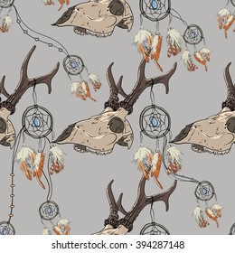 Vector seamless pattern with deer skull and dreamcatcher. Profile view. Boho style. Dearer roe skull.