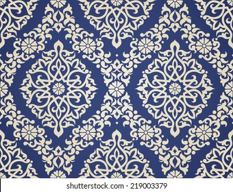 Vector seamless pattern in Eastern style. Beige monochrome element for design. Ornamental lace tracery on blue background. Ornate floral decor for wallpaper. Endless texture. Contrast pattern fill.