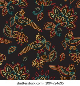 Vector seamless pattern in ethnic style.Exotic birds, colorful contour thin line fantasy flowers with folk ornaments on a black background. Embroidery, wallpaper, textile print, wrapping paper