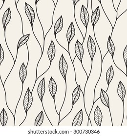 Vector seamless pattern. Floral stylish background. Graphic repeating texture. Hand drawn branches with leaves.