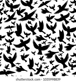 vector seamless pattern with flying birds silhouettes, hand drawn background with songbirds