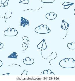 Vector seamless pattern with freehand drawn cartoon paper planes and clouds on blue background