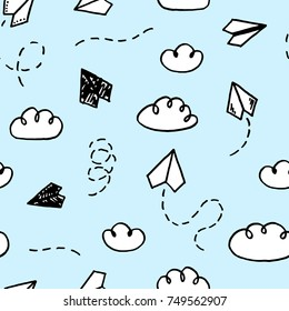 Vector seamless pattern with freehand drawn cartoon paper planes on blue background