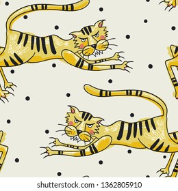vector seamless pattern with funny tigers on a dotted background