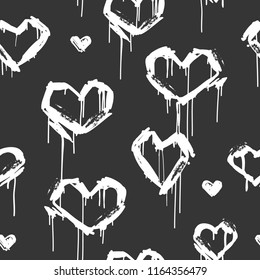 Vector seamless pattern with graffiti white hearts tags in grunge style on black background. Hand drawn hearts endless bafground