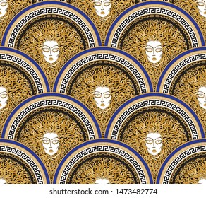 Vector seamless pattern with Greek meander black borders in fish scale order. Medusa Gorgon face, fan shaped serpent hair.Gold, beige, indigo blue Art deco wallpaper, wrapping paper, silk print