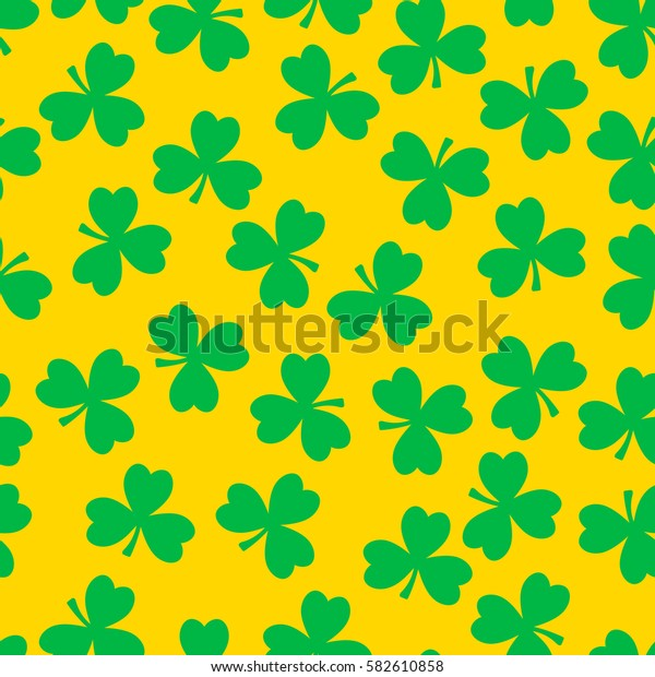 Vector seamless pattern. Green clover on a yellow background. National holiday St.Patrick 's Day.