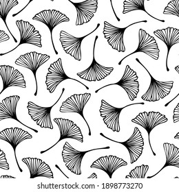 Vector seamless pattern with hand drawn ginkgo biloba leaves. Beautiful design for textile, wallpaper, wrapping paper.