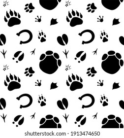 Vector seamless pattern of hand drawn different animals paws footprint isolated on white background