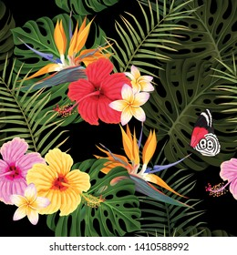 Vector seamless pattern with hibiscus flowers and palm leaves on black background