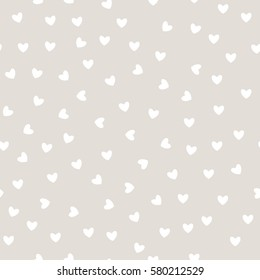 Vector seamless pattern. Inspired by Memphis Design. Trendy texture with a jumble of hearts. Abstract background with love theme.