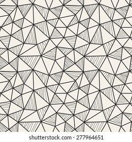 Vector seamless pattern. Irregular abstract linear triangles. Graphic hand drawn background. Doodle monochrome texture. Repeating monochrome sketch with filling hatching.