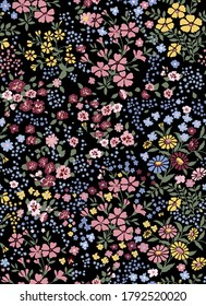 Vector seamless pattern of little flowers on black background, millefleurs, romantic mood. 70s fashion