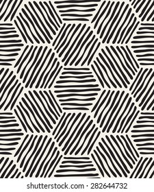 Vector seamless pattern. Modern stylish texture. Repeating geometric background. Striped hand drawn hexagons.