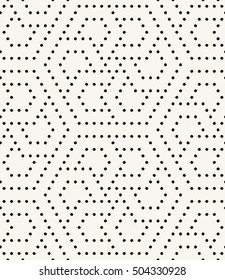 Vector seamless pattern. Modern stylish texture. Repeating geometric tiles with filled dots. Regular hipster background. Small circles form hexagonal ornament.