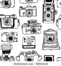 Vector seamless pattern with old fashioned cameras. Hand drawn set of vintage photo camera.