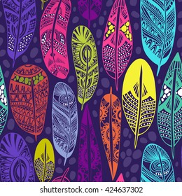 Vector seamless pattern of ornamental boho feathers