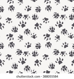Vector seamless pattern with paw footprints of a dog (wolf). Cute hand drawn steps drawn with watercolors. Monochrome texture for consumer industry design