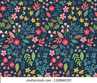 Vector seamless pattern. Pretty pattern in small flower. Small multicolor flowers. Dark blue background. Ditsy floral background. The elegant the template for fashion prints.