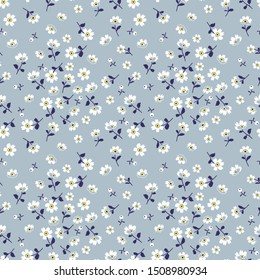 Vector seamless pattern. Pretty pattern in small flower. Small white flowers. Pale blue background. Ditsy floral background. The elegant the template for fashion prints.
