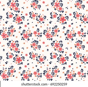 Vector seamless pattern. Pretty pattern in small flower. Small red-orange flowers. White background. Ditsy floral background. The elegant the template for fashion prints.