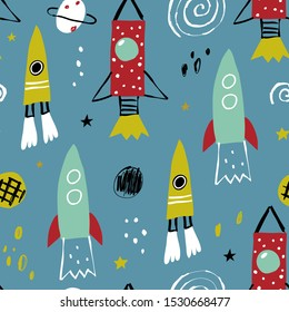 Vector seamless pattern with rocket, planets and stars. Seamless vector texture for baby design. Seamless pattern with cartoon space adventure, planets and stars.