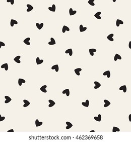Vector seamless pattern. Simple repeating texture with chaotic hearts. Stylish hipster texture.