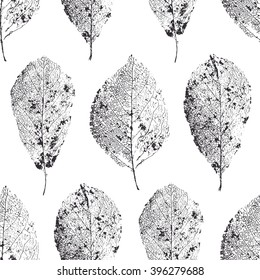 Vector seamless pattern with skeletonized leaves. Dry leaves with veins.