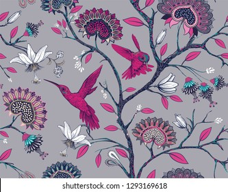 Vector seamless pattern with stylized flowers and birds. Blossom garden with hummingbirds and plants. Gray and pink floral wallpaper. Design for fabric, textile, wallpaper, cover. Vector clipart.