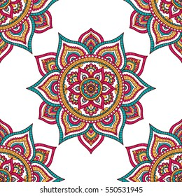 Vector seamless pattern with tribal mandala. Ethnic background with doodle ornament. On white backdrop. Red, green, white and yellow colors.