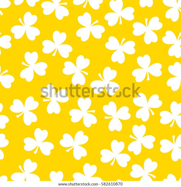 Vector seamless pattern. White clover on a yellow background. National holiday St.Patrick 's Day.