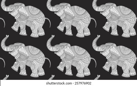 Vector seamless pattern of white elephant silhouette with  ethnic tribal ornament  on black background