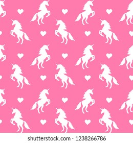 Vector seamless pattern of white unicorn silhouette with heart isolated on pink background