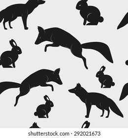 Vector seamless pattern with wild animals foxes and rabbits
