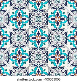 Vector seamless texture. Beautiful colored pattern for design and fashion with decorative elements. Portuguese tiles, Azulejo, Talavera; Moroccan ornaments in blue and orange colors