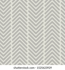 Vector seamless texture pattern in grey. Simple vertical chevron made into repeat. Great for background, wallpaper, wrapping paper, packaging, fashion.