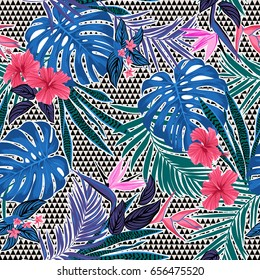 Vector seamless tropical pattern with small triangles at background, vivid tropic foliage, monstera leaf, palm leaves, bird of paradise flower, hibiscus in bloom. modern bright summer print design