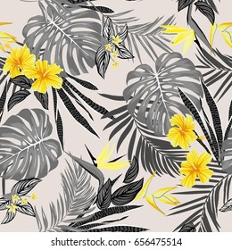 Vector seamless tropical pattern, vivid tropic foliage, with monstera leaf, palm leaves, bird of paradise flower, hibiscus in bloom. modern bright summer print design